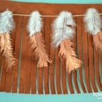 Copper Dipped Feather Banner hanging atop leather fringe banner