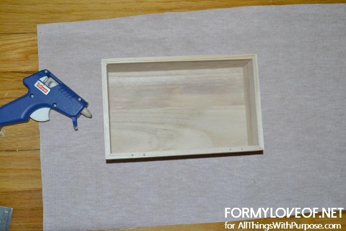 hot glue box onto center of pre cut lather like fabric