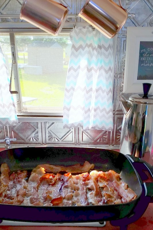 cooking in a vintage camper