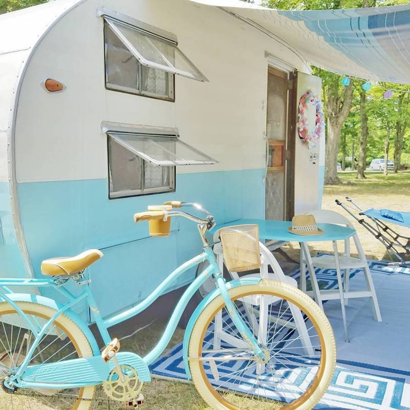 Vintage camper and turquoise bike perfection!