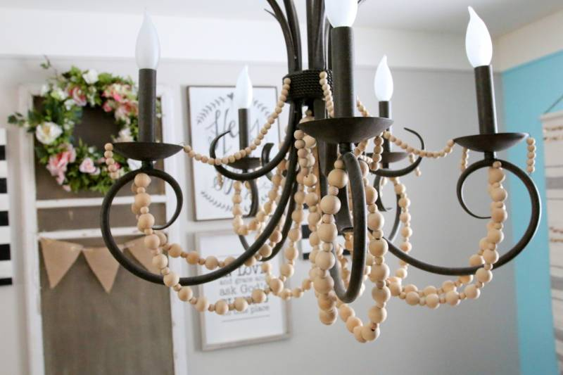 Get the look wood bead chandelier diy all things with purpose i read several tutorials on how to create a wood beaded chandelier from scratch but ultimately wanted something fast and cheap aloadofball Images